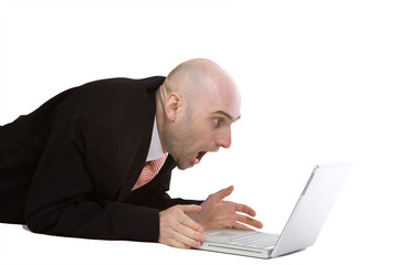 Amazed businessman using laptop