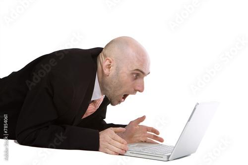 Amazed businessman using laptop