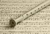Flute on a music sheet