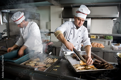 Two chefs at work in a restaurant - 7867467