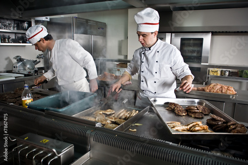 Two chefs at work in a restaurant - 7867475