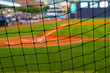 Baseball field, shot from behind the net at home plate