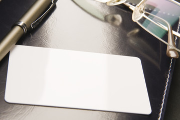 _White business card lays on organizer_