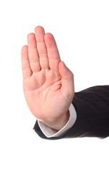 Men's hand signaling stop against