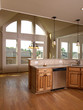 Luxury Model Home Maple Kitchen with window 3