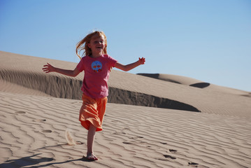 Young Girl Running on Sand Dune