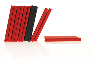 a lot of red books with a black one in between