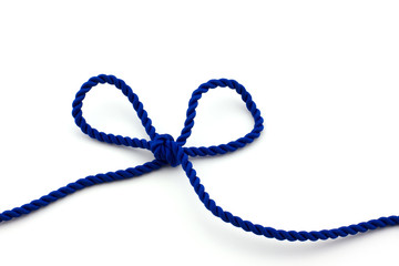 Blue rope tied in a bow, isolated