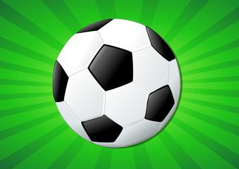 Ballon de football sur fond vert