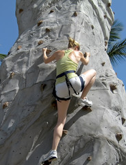 Young lady rock climbing