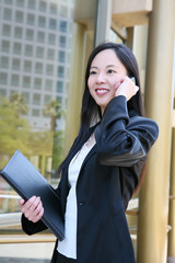Asian Business Woman on Phone at Office Building