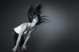 Beautiful girl shaking her head, monochrome poster