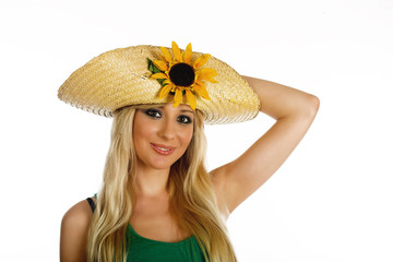 Beautiful blonde girl with summer hat and sunflower on white