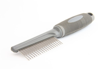 Pets comb with two rows of prongs on white background