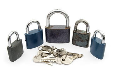 five locks and several keys isolated on white background
