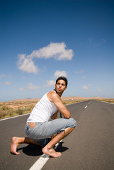 man on the road with jeans