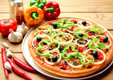 Fototapety Pizza on metal dish and vegetable