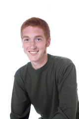 Red headed teenage boy with sideburns and a friendly smile