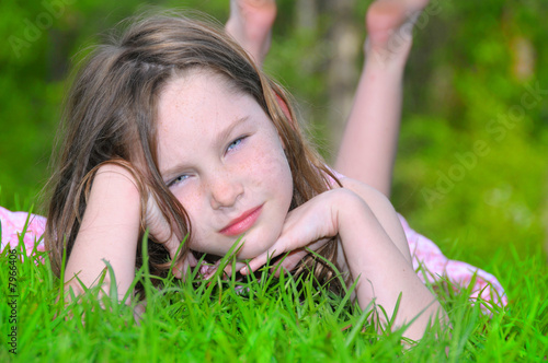 Young girl relaxing on lawn