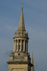 tower with spire, columns, windows, and balustrades