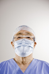Portrait of senior doctor in surgical cap and mask