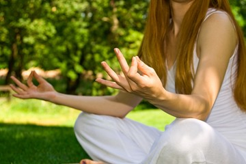 woman in white in yoga outdoor pose