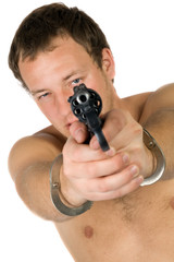 The young man with a pistol. Isolated