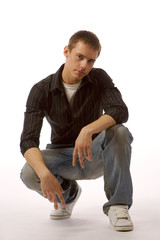 The young man posing in studio