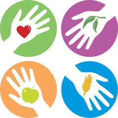health related hands with apple, heart, wheat and plant