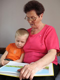 grandson and grandmother read a book poster