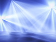 blue lights on a club stage in clots of a smoke