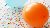 Blue and orange balloons with confetti poster