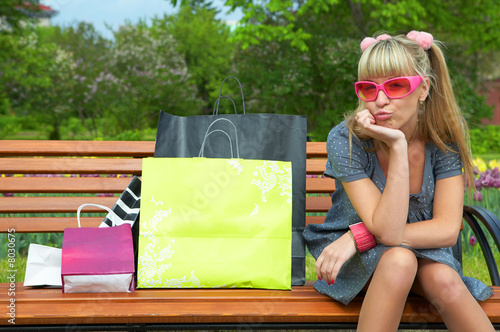 shopping blond woman in pink glass