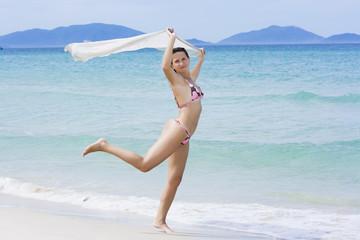 Woman dancing on the beach