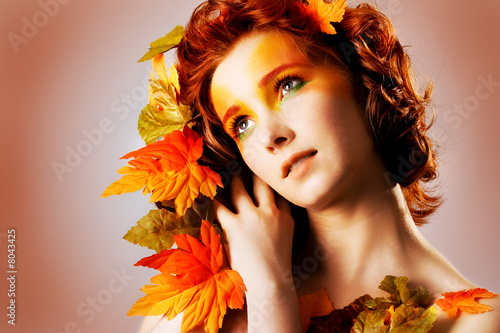 Autumn portrait of a beautiful female