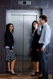 Businesspeople waiting for elevator poster