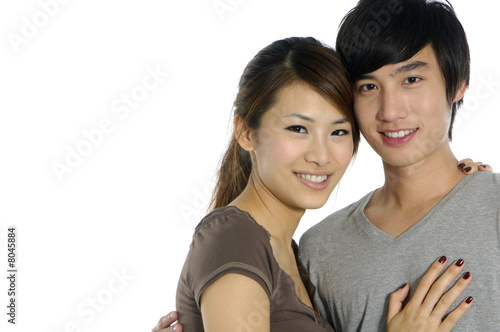 Young happy couple on white backgroung