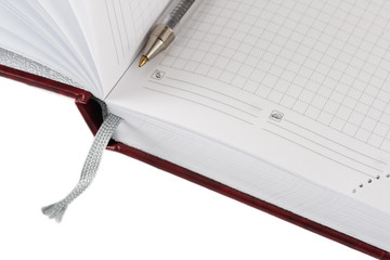 Opened diary planer with pen