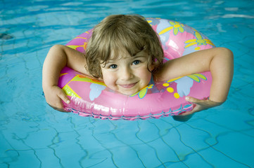 Little girl with inner tube