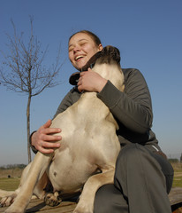 laughing girl and big dog