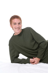 Attractive teenage boy with red hair, freckles, and sideburns.