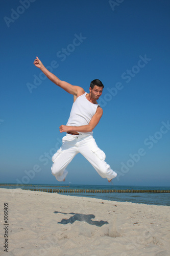 white dressed jumping men on the sea