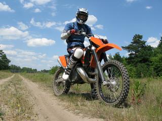 raider sitting on the motocross bike