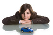 young woman dreaming with new car
