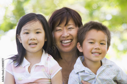 Grandmother laughing with grandchildren