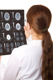 Female doctor examining a brain cat scan. poster