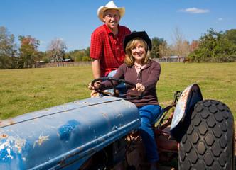 Mature Farm Couple on Tractor