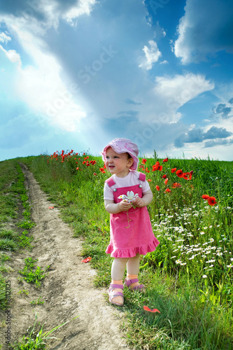 canvas print picture Baby on a lane amongst a field