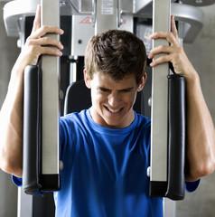 A young man exercising