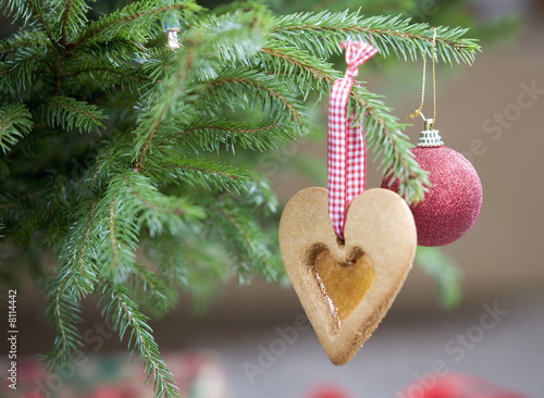 Christmas decorations hanging on a tree